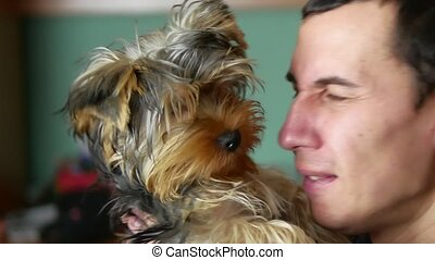 The man is friendly with the dog. Love of pets