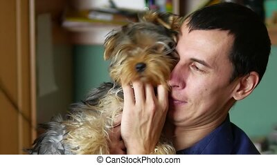 The man is friendly with the dog. indoor love of pets