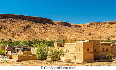 A village with traditional kasbah houses in Ziz Valley,...