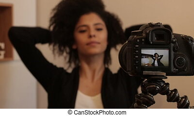 Influencer fixing hair for shooting video - Young female...
