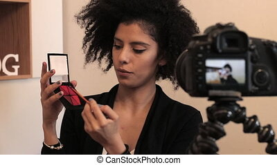 Makeup vlogger influencer creating cosmetic product...