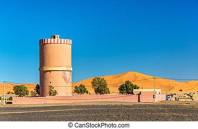 Water tower in Merzouga village at Sahara Desert, Morocco -...