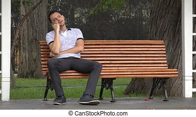 Happy Man Daydreaming Alone In Park