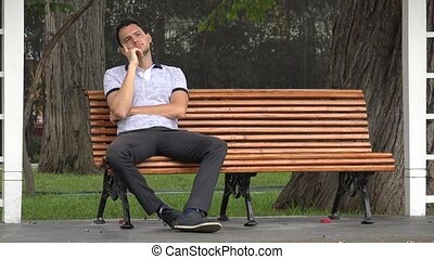 Man Sitting Alone In Park