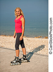 woman rollerskating on the beach