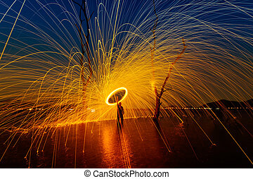 Burning Steel Wool spinning,Circle fire at sunset