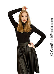 beautiful young blonde girl in a leather black skirt - Image...