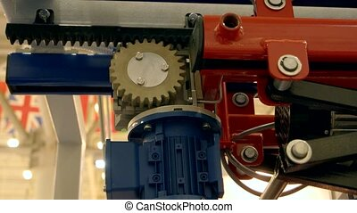 Motorized winch in motion. Gear and electric motor. Strength...