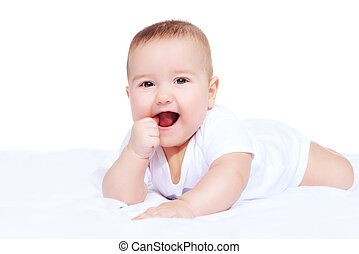 laughing infant baby - Cute little baby lying on the blanket...