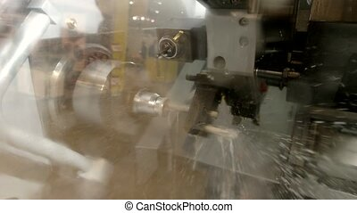 Action of lathe. Metal turning machine.