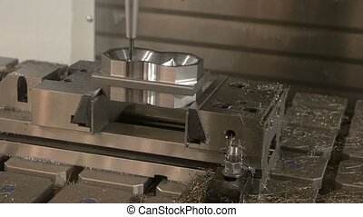 Working milling machine. Steel detail and swarf. From rough...