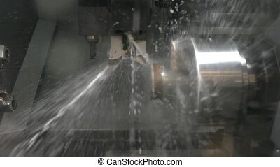 Lathe in action closeup. Splashes of water. Cnc machine...