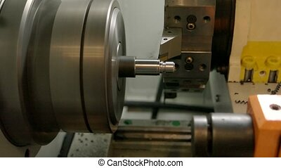 Metal turning lathe in action. Production of steel detail....