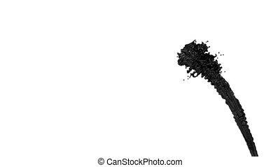 fountain of black paint like car paint or black oil on white...