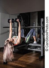 Sports background. Muscular fit woman exercising. - Portrait...