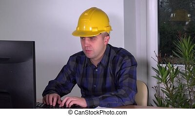 real estate agent sales man with helmet working with...