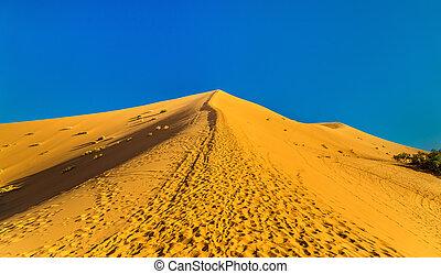 Climbing a dune near Merzouga in Morocco - Climbing an Erg...