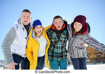 Cheerful group of friends posing for the camera. Two young...