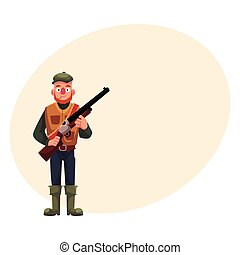 Funny hunter in hunting vest and rubber boots holding rifle...