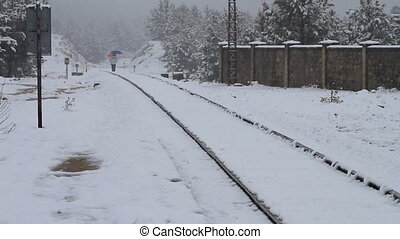 walking and snow - walking over railways while snowing