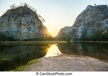 Beautiful view of reservoir and mountain at Khao Ngu Rock Park in Ratchaburi with sunset