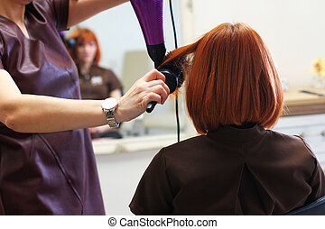 Woman in barber shop - Woman waiting for styling hair in...