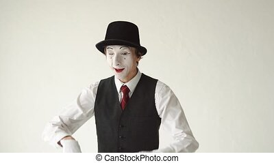 romantic MIME on a white background. MIM looks at the camera and shows hearts