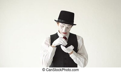 man mime standing on white background and crying bitter...