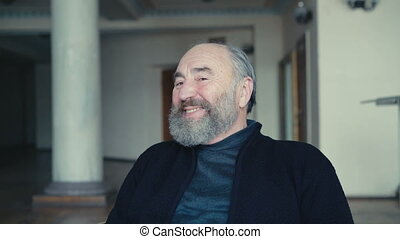 Charismatic flirty old man smiling and playing