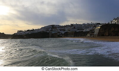View of the beach at Albuferie, Portugal at twilight - A...