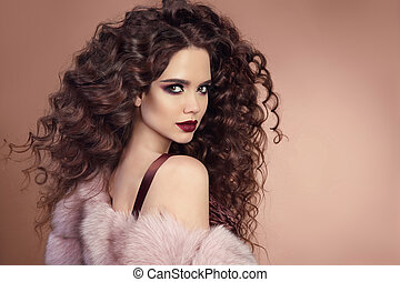 Hairstyle. Fashion brunette girl with Long curly hair,...