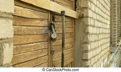 Padlock on the Door - The padlock on the door of the shop in...
