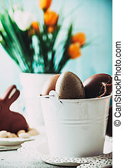 Easter table with decoration - Easter. Chocolate Eggs and...
