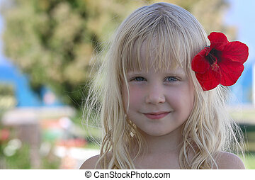 beautiful girl with flower - summer travel background