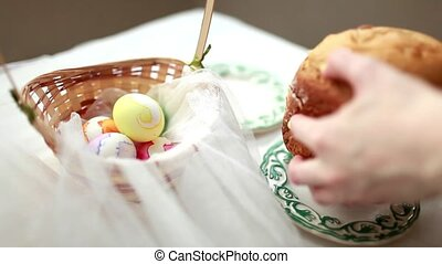 The girl puts on the table the blank for the Easter cake....