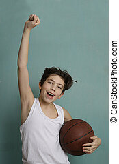 teenager boy with basketball ball