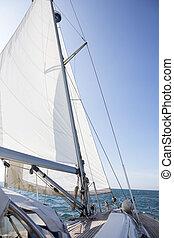 Yacht Sailing On Sea Against Blue Sky