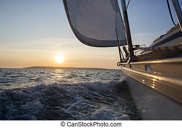 Sail Boat Sailing In Sea During Sunset - Sail boat sailing...