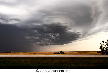 Storm clouds with heavy rain during harvest in Saskatchewan