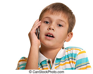 Serious kid talking over the phone - A handsome dreaming boy...