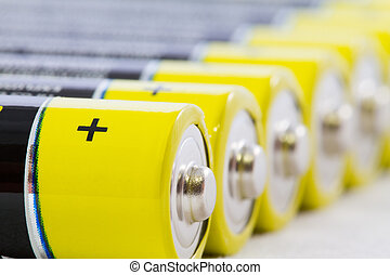 Close-up of yellow black AAA alkaline batteries isolated on...
