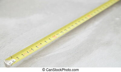 The tape measure lies on the floor - The tape measure lies...