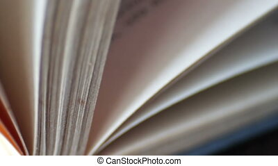 Book pages turning.Scrolling a Book in Macro.Turning the...