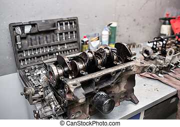 Engine crankshaft, valve cover, pistons. mechanic repairman at automobile car engine maintenance repair work