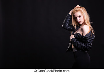Hot sexy girl with no bra in leather jacket on black...