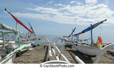Traditional wooden boats for tourists. Indonesia Bali...