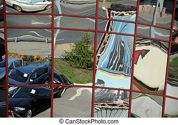 Distorted Reflection of Cars and Buildings - Distorted...