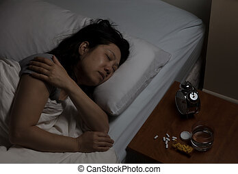 Mature woman in physical pain while trying to sleep - Mature...