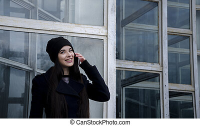 Beautiful girl on the building background - Young girl in a...