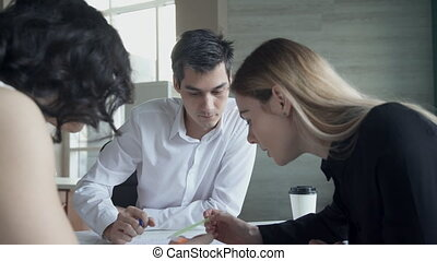 Business meeting of women man sitting at table inside office.